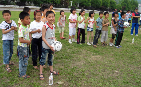 Children playing football in China