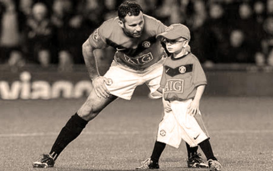 foto di Ryan Giggs con bambino